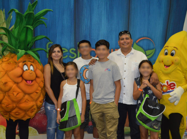 All Smiles with Jaimes Family—FreshPoint Central California—Family Fun Day-blur