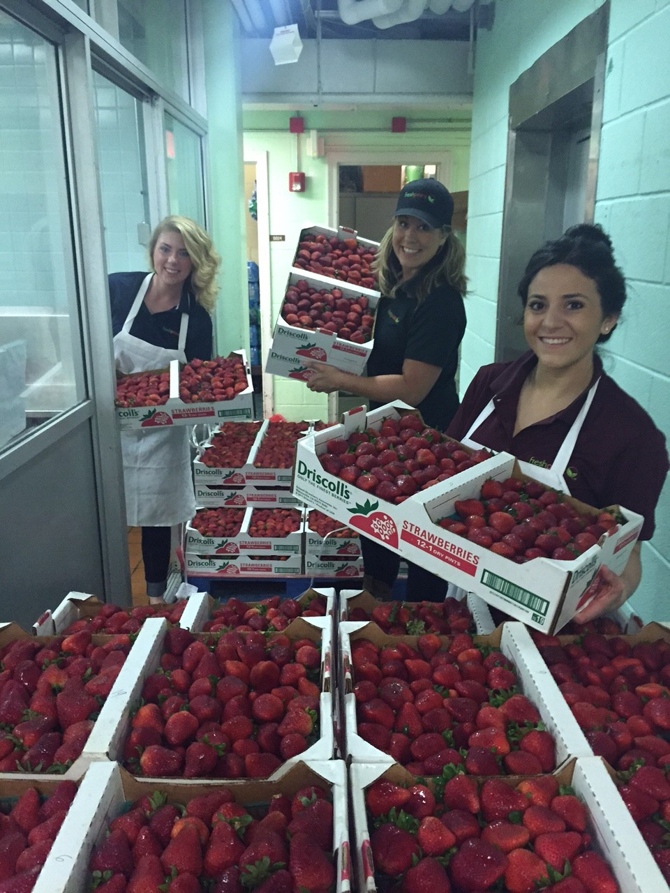Freshpoint Sales reps washing berries from left to right – Daeghan Hawke, Jessi Daschner, Antonina Castagnola